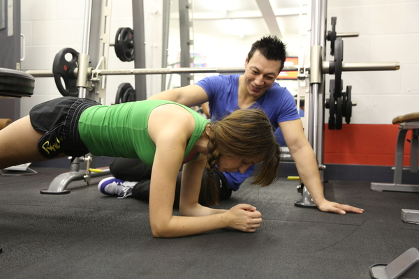 James Schofield working perfect plank form with a client