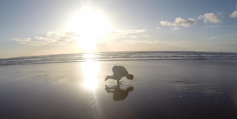 schof-crow-pose-muriwai-beach.png