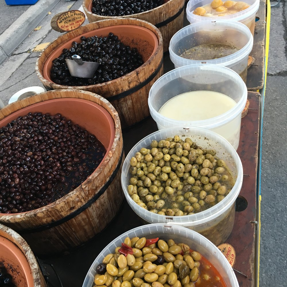TUBS of olives and hummus