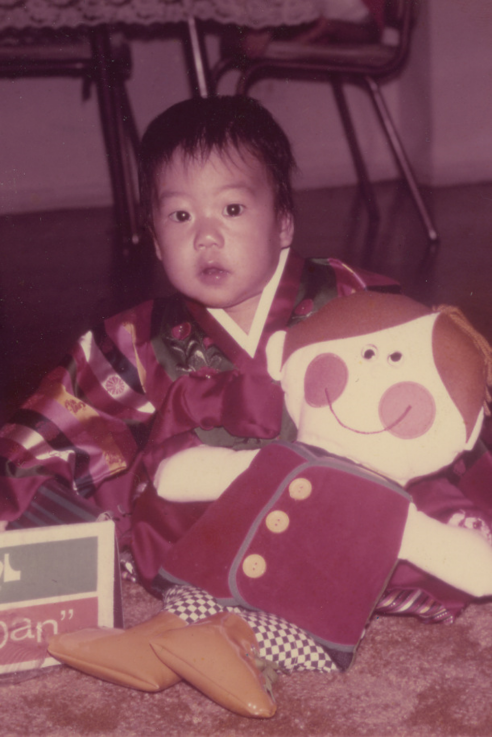 Me on my first birthday, or Dol (in Korean). I am wearing my birthday hanbok (traditional dress). This pic was taken moments before my 3-yr old brother took my Dapper Dan away from me.