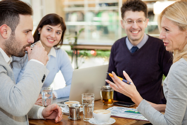 Group of business people  meeting in coffee shop and holding a business presentation