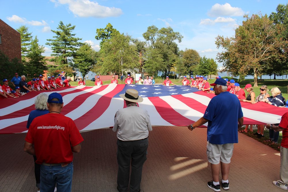 Veterans with giant flag.jpg
