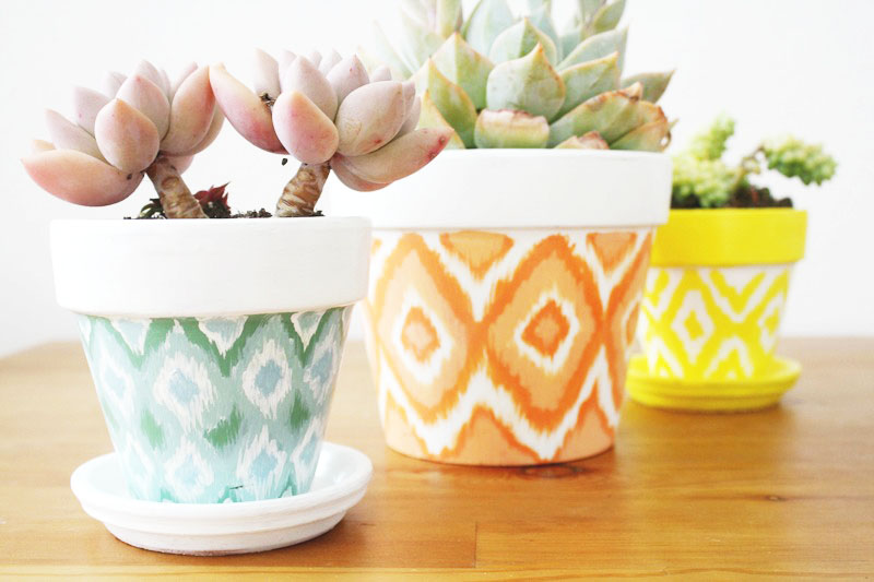 DIY Hand Painted Ikat Pots. This is one of my favorite DIY projects, it's so easy and looks amazing. Love these pots for inside or outside and they make great gifts. Love!