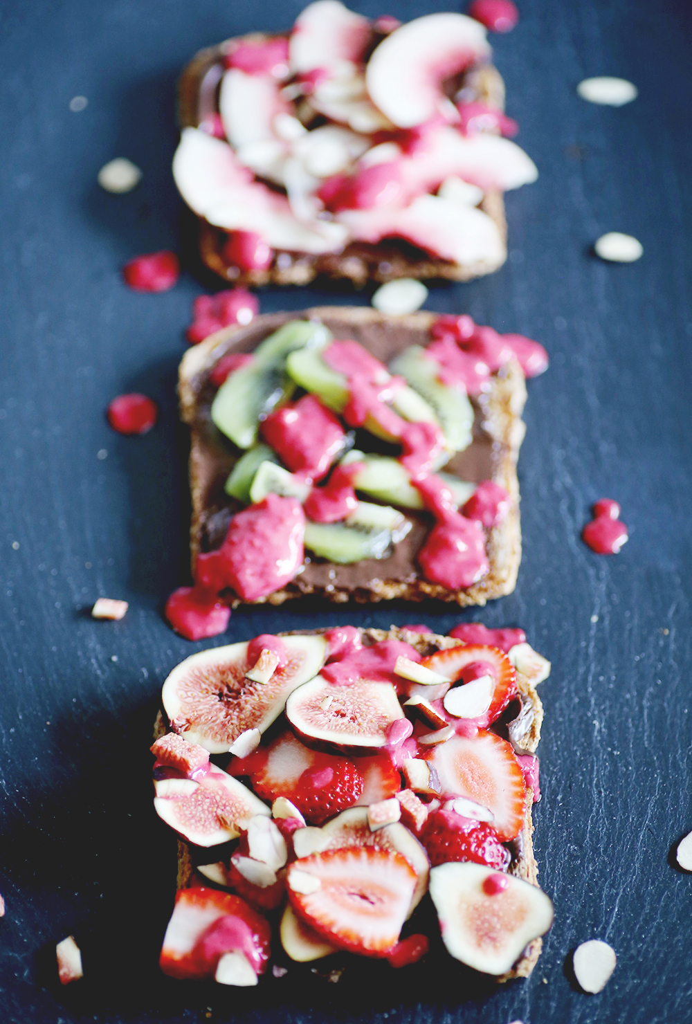 Sweet toast with Chocolate Almond Butter from Trader Joe's. Top with your favorite fruit and a yummy homemade raspberry coconut cream. Can be eaten for breakfast, as a snack or after dinner dessert.
