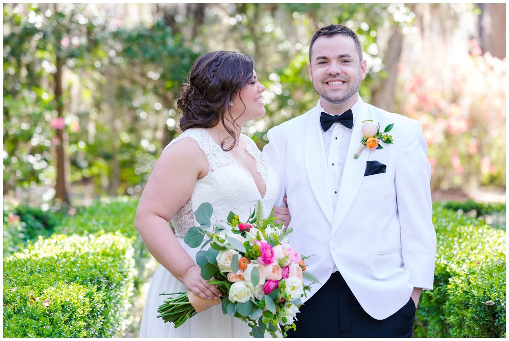 bride looks at groom and laughs