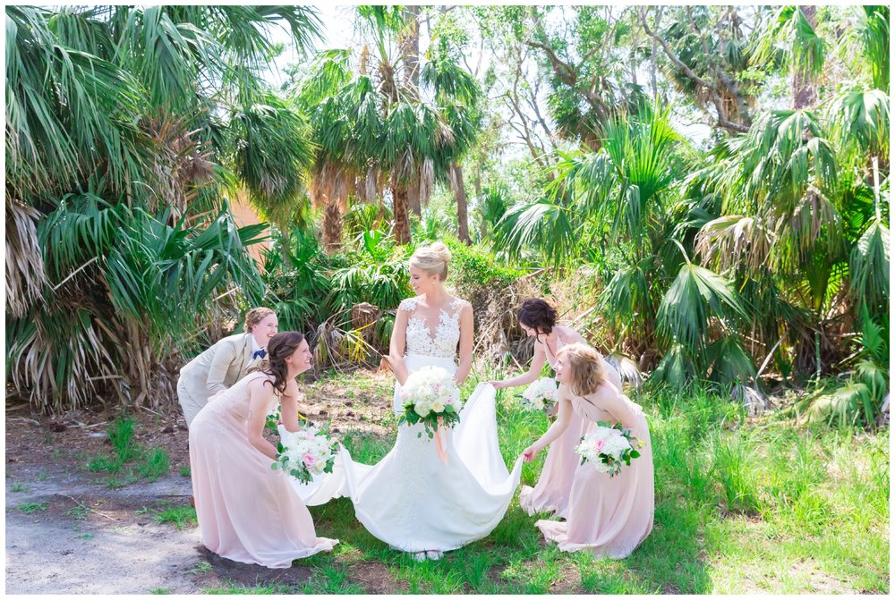 bride and her bridesmaids fluffing