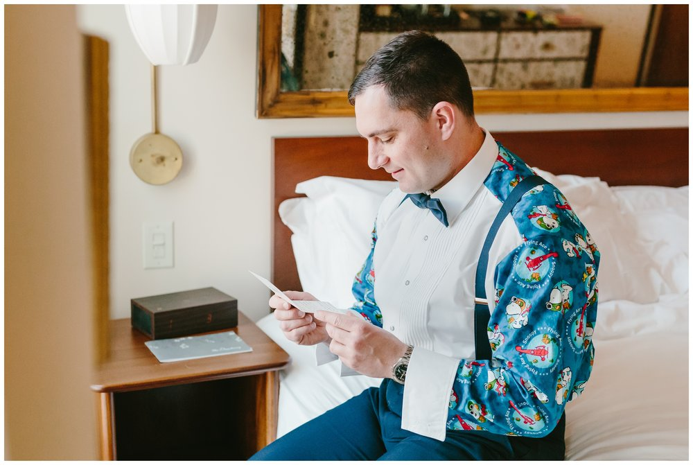 groom reading an emotional letter from his bride