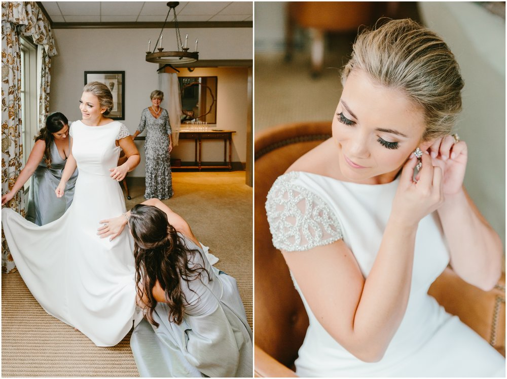 bride getting into her pronovias wedding gown