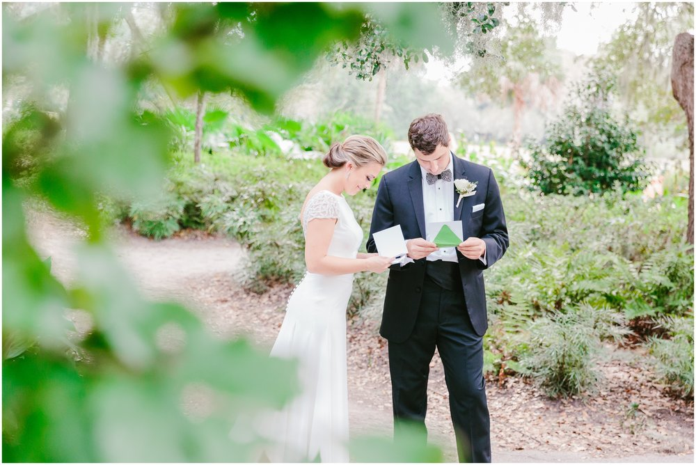 bride and groom read their letters from each other