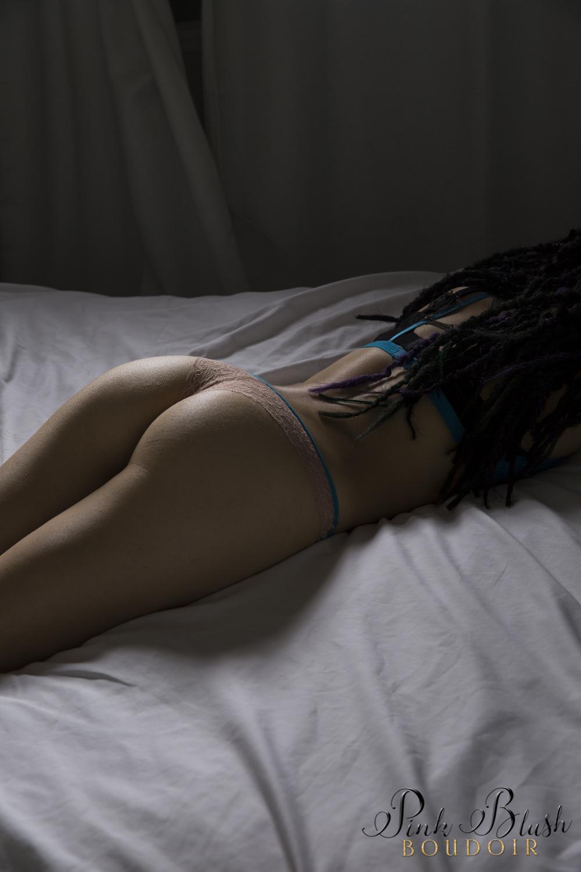 Boudoir Photography Edmonton, dramatic lighting of a women's butt