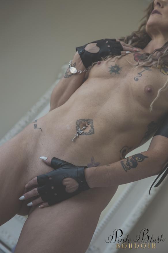 Edmonton Boudoir, a woman wearing black gloves standing naked