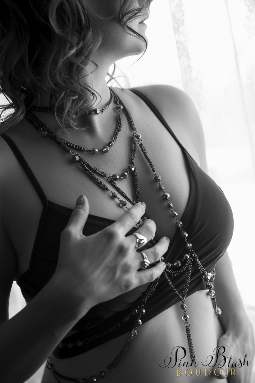 Boudoir Photography, a woman standing in front of a window
