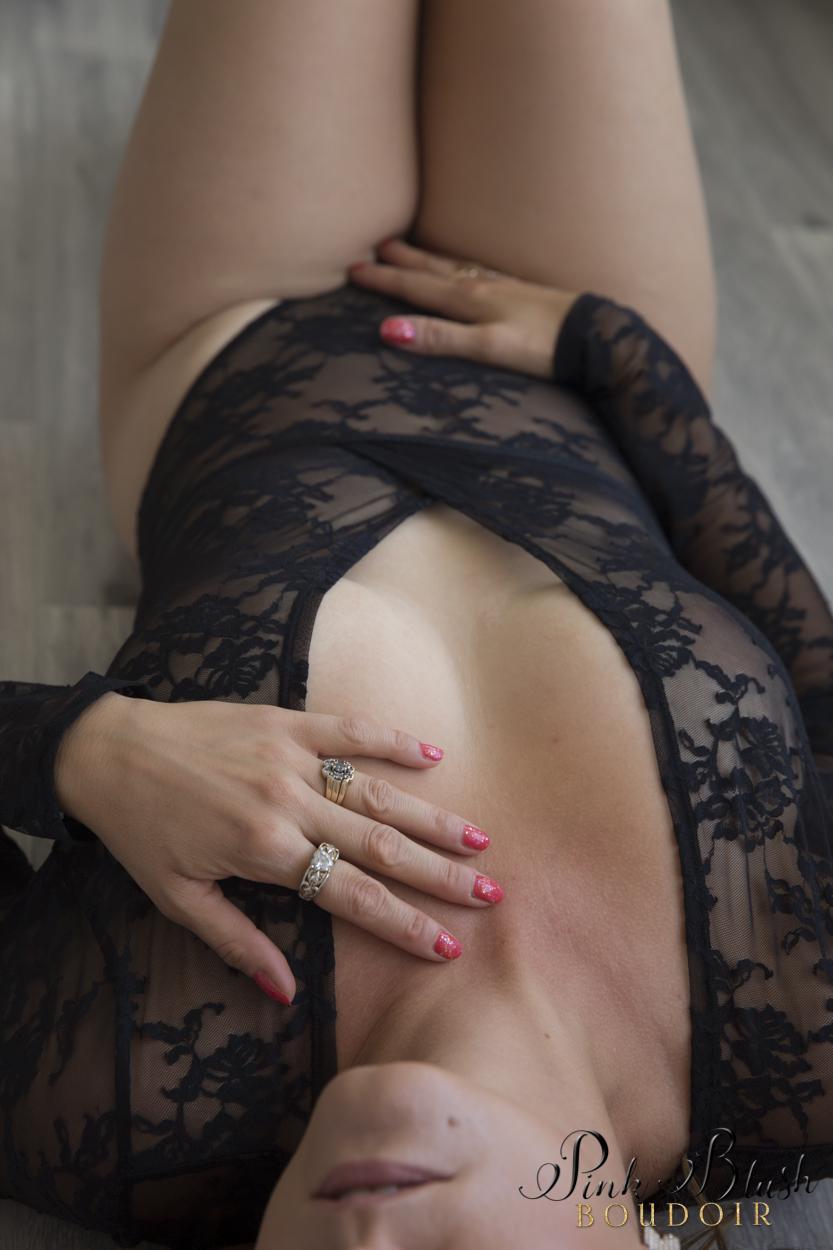 Boudoir Photography, a woman in a black lace body suit