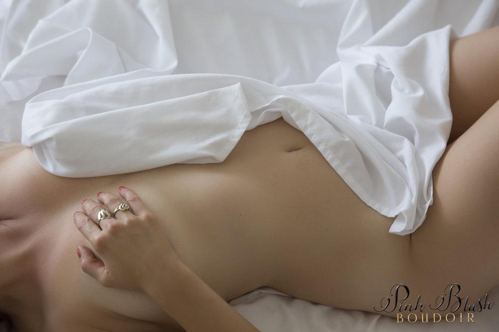 Boudoir Photography, a woman's body draped in a white sheet
