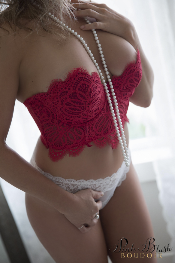 boudoir photos, a woman's body wearing a red bra and pearls