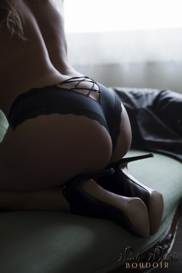 boudoir photos, a woman's butt kneeling on a green couch