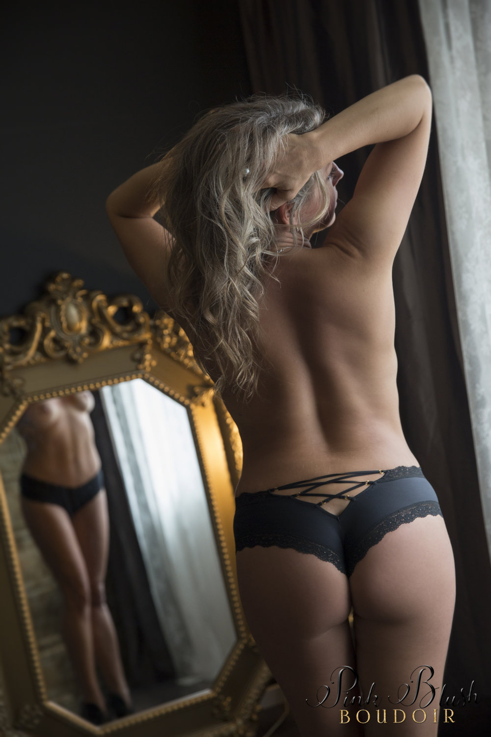 boudoir photos, a topless woman standing in front of a mirror