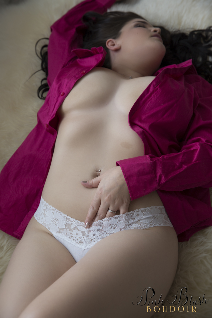 boudoir photography, a woman wearing white panties and a pink button up shirt