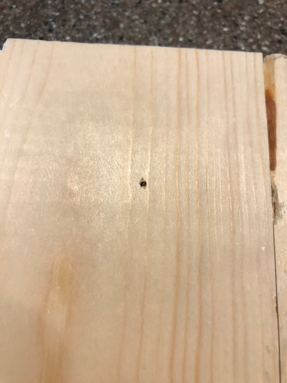 This is where one of my screws was just a little too long, and came through the front. Luckily, my stain is darker and will hide this well.
