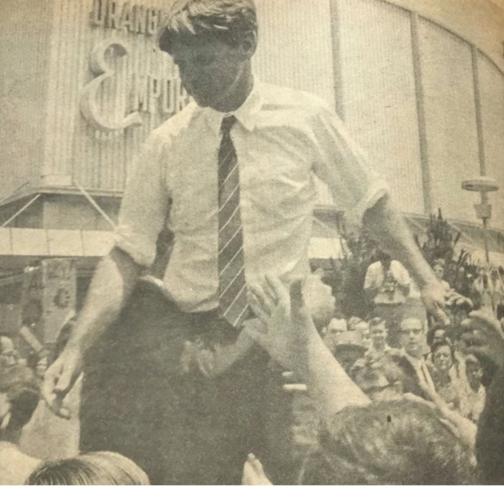 Robert F. Kennedy greets well-wishers on May 20, 1968 on Pomona's East Second Street. (Courtesy Claremont Courier)