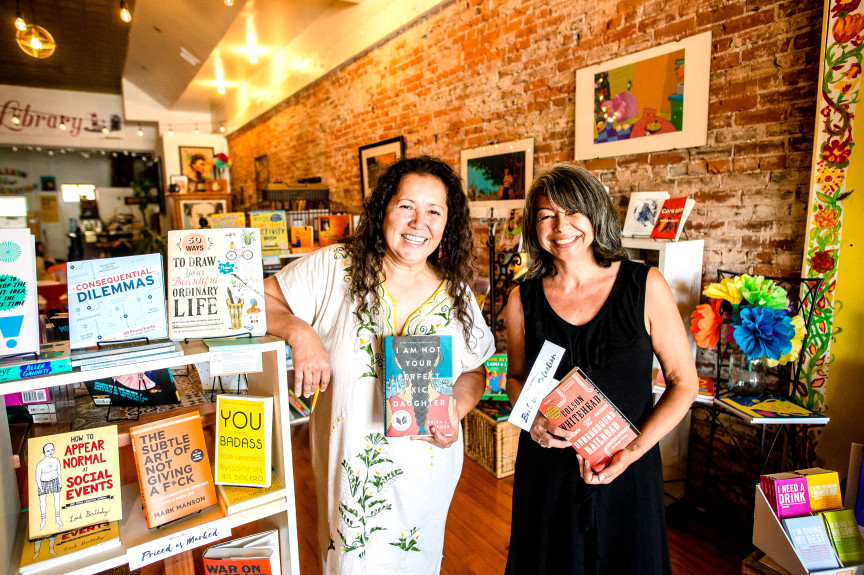 Adi Bautista, left, and Pati DeRobles, owners of Cafe Con Libros, a nonprofit bookstore, lending library and meeting space in downtown Pomona on Wednesday, July 25, 2018. (Photo by Watchara Phomicinda, The Press-Enterprise/SCNG)
