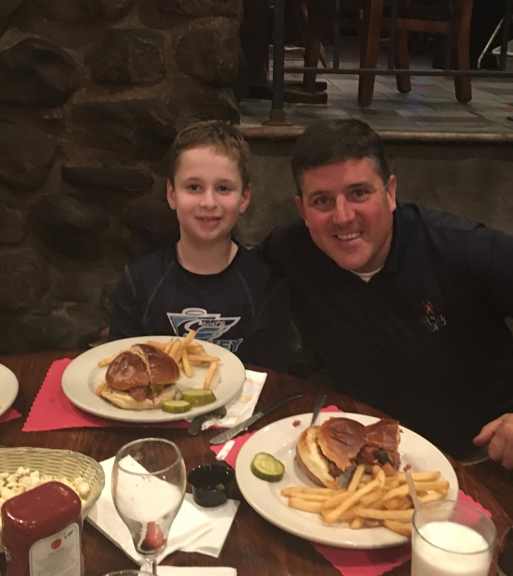 Chris Kunisch with Burger of the Week winner Brookside School 4th grader, Gabriel Kay.