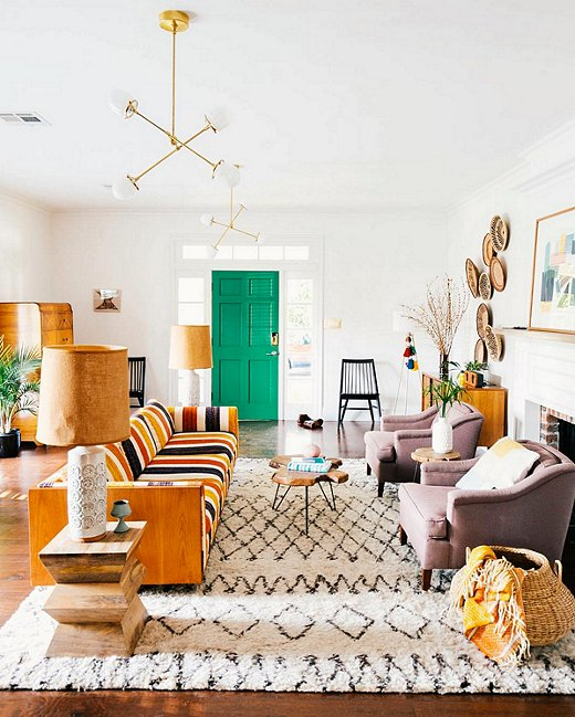 Vintage vibes abound, using complimentary vintage pieces and poppy bright colors (such as on the door) can be party in the front and business in the back. We love how these vintage pieces mesh so well with the new ones! That rug really pulls everything together also by adding playful texture. ( source )