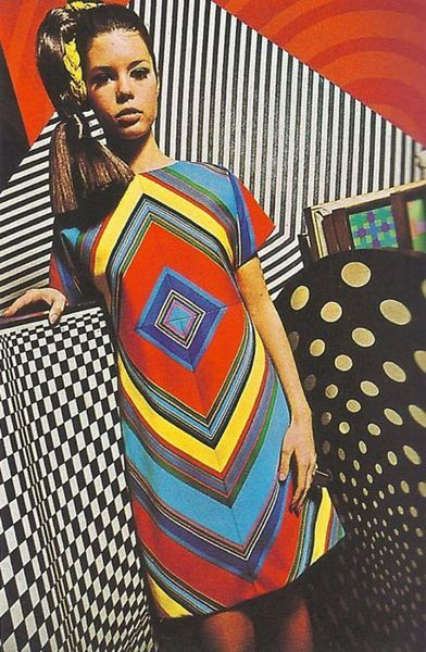 This show-stopping op art dress with vibrant colors is AMAZING. ( is )