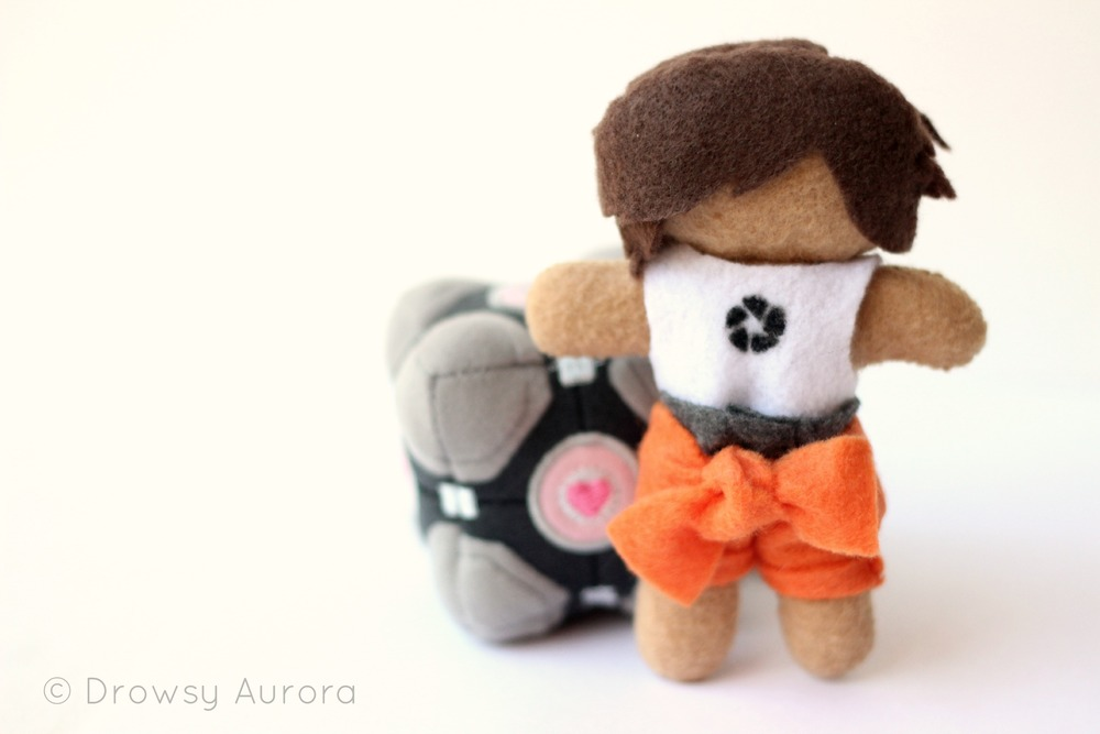 Chell and a companion cube (ThinkGeek)