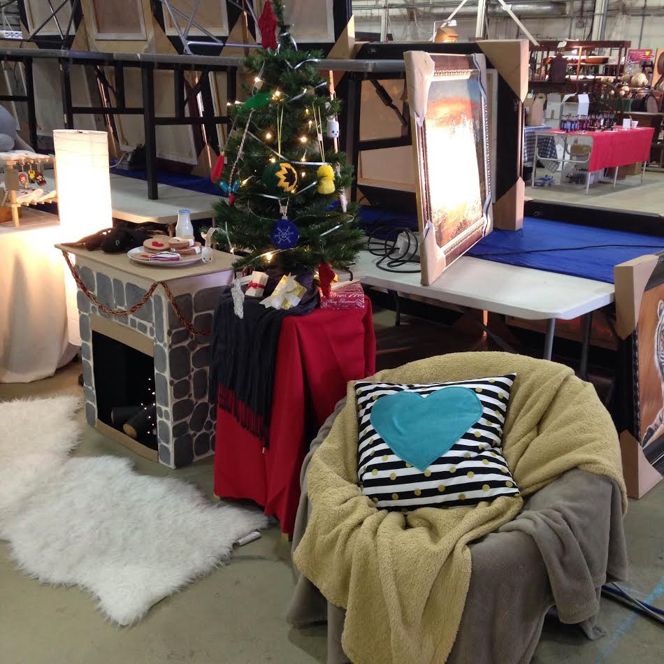 """The back half of my booth. I was going for """"cozy living room Christmas"""""""