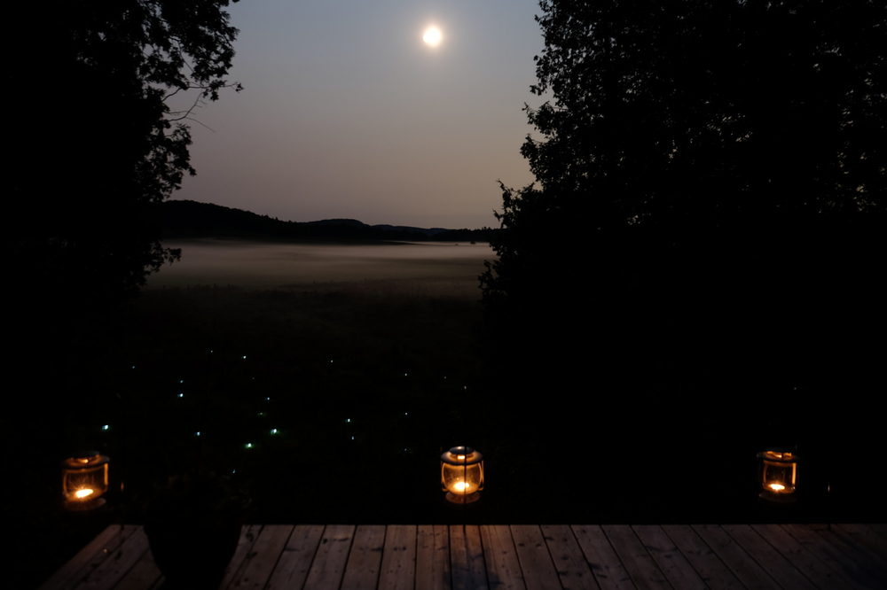 A view of the August harvest moon + rising mist from the 'moon viewing platform' - with a constellation of solar lights
