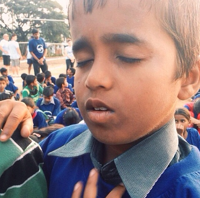 Shown here is one of my favorite photos from our last trip to India.. Language barriers cannot keep the Love of God from getting through to a young man's heart. We love seeing children accept Jesus as their Savior.