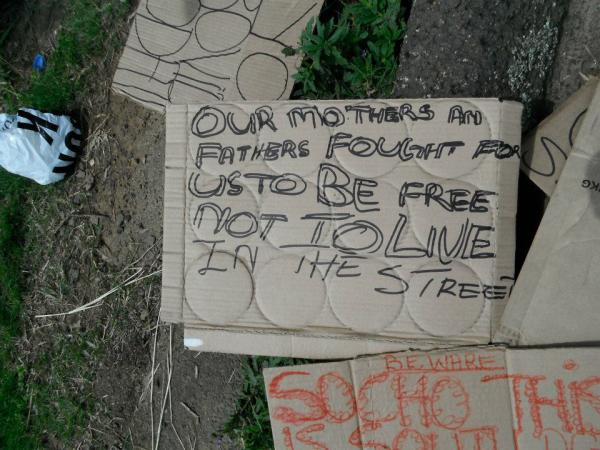Discarded signs used in protest by residents illegally evicted from Valley View social housing complex, Hillary, Durban (2011).