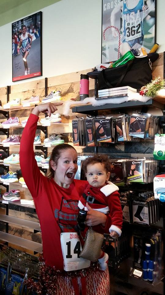 Chrissy and her son, checking out her nutrition book on sale at Marathon Sports!