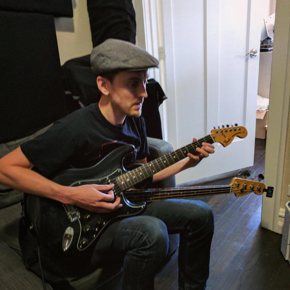 Curtis recording guitar and bass