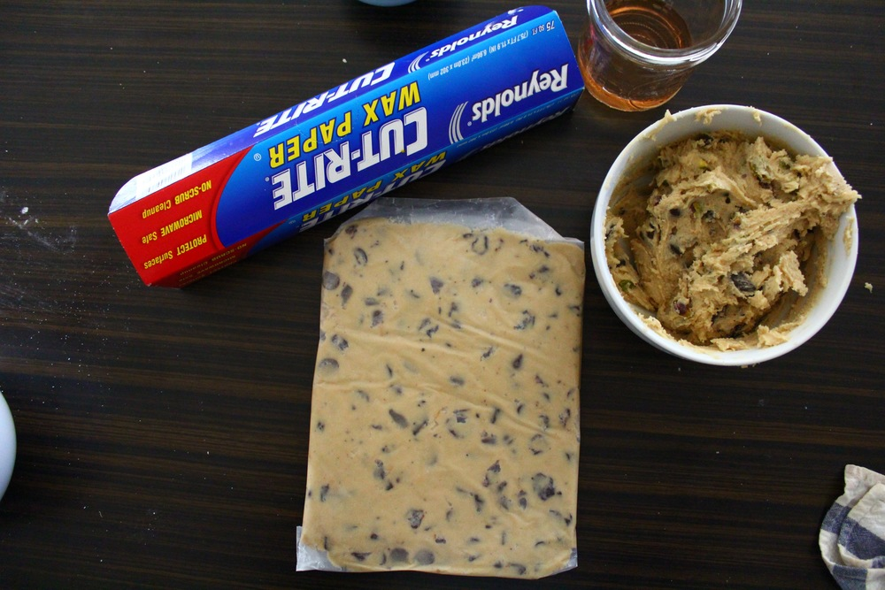 because i do not have a cookie scoop, and often have uneven-sized cookies that bake unevenly, i choose to spread my cookie dough out on waxed paper -to be cut into roughly even sized squares.    this is post refrigeration