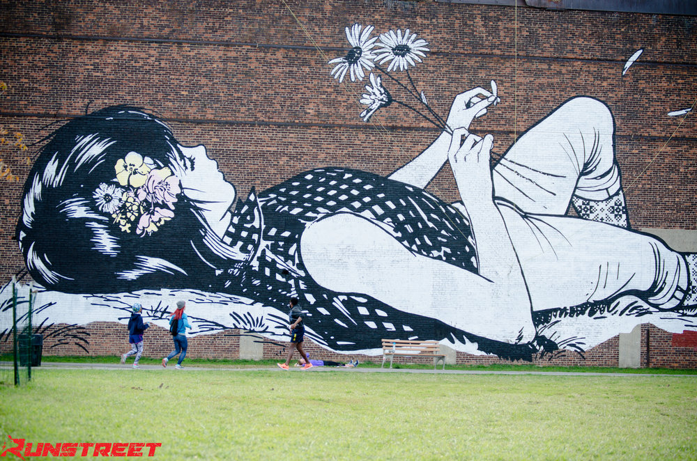 In awe of mural by  Faile  in Greenpoint, Brooklyn.