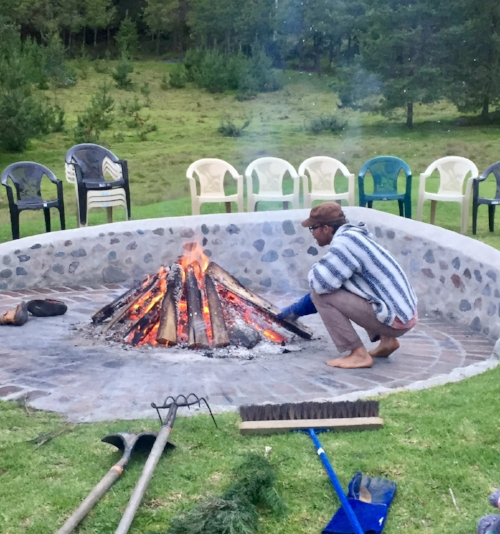 Keeping the sacred fire for the sweat lodge at Gaia Sagrada