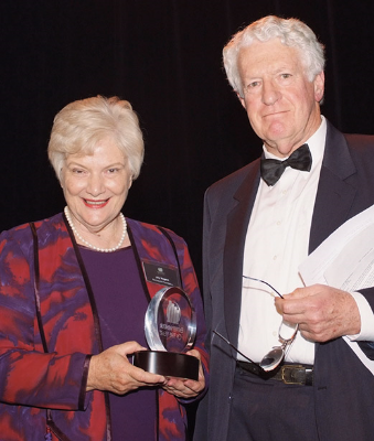 Joy receiving her social entrepreneur (Central region) award in 2007, with Bill Wood.