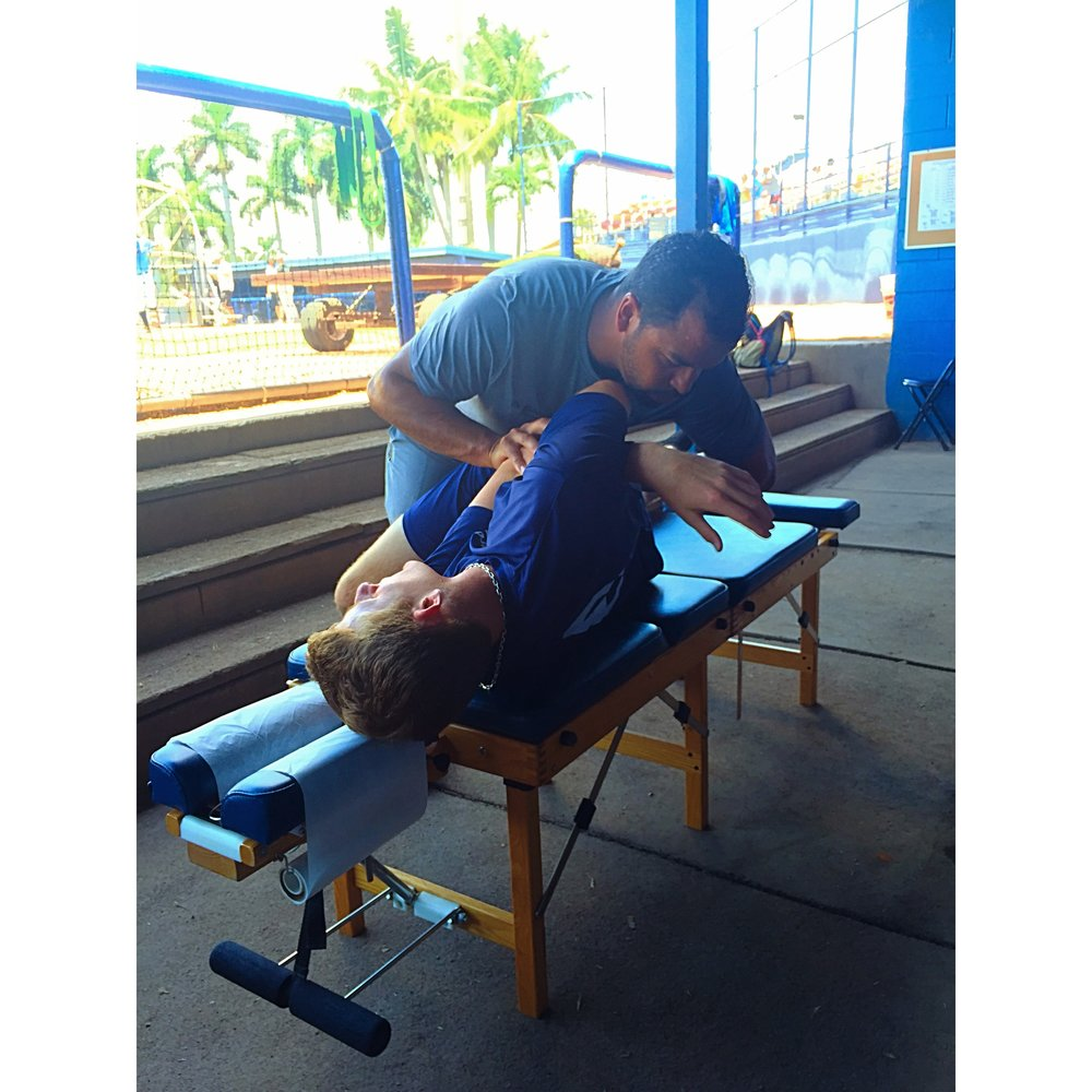 Dr. andrew bosier providing chiropractic care at the South florida collegiate baseball league allstar game