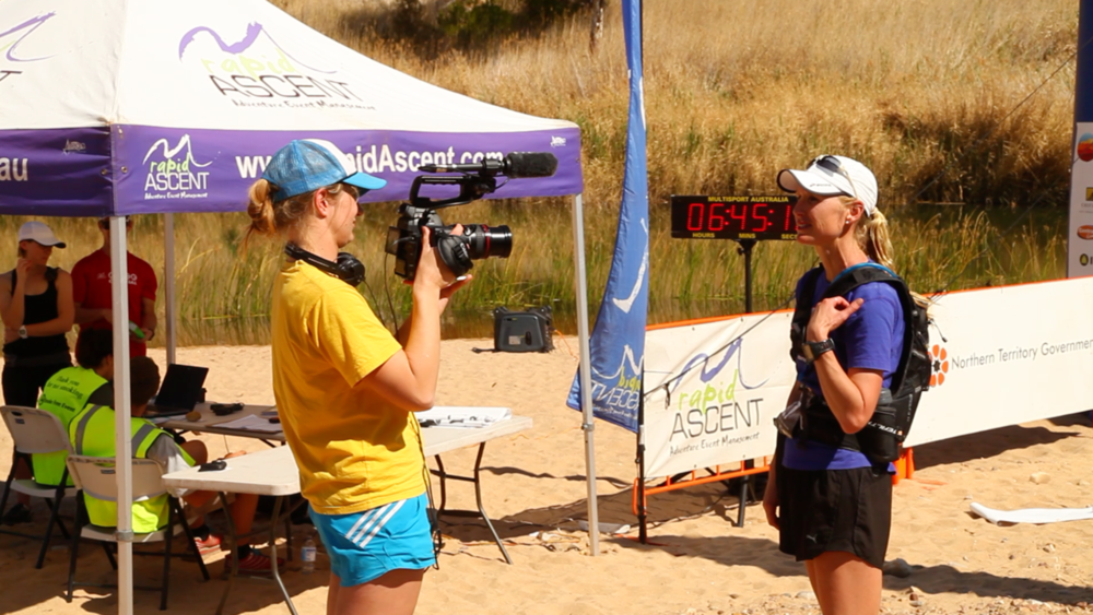 The Trail Beyond - Director Cassie De Colling filming Donna Urquart immediately after she crossed the finish line of the Larapinta stage race in the Northern Territory, Australia.