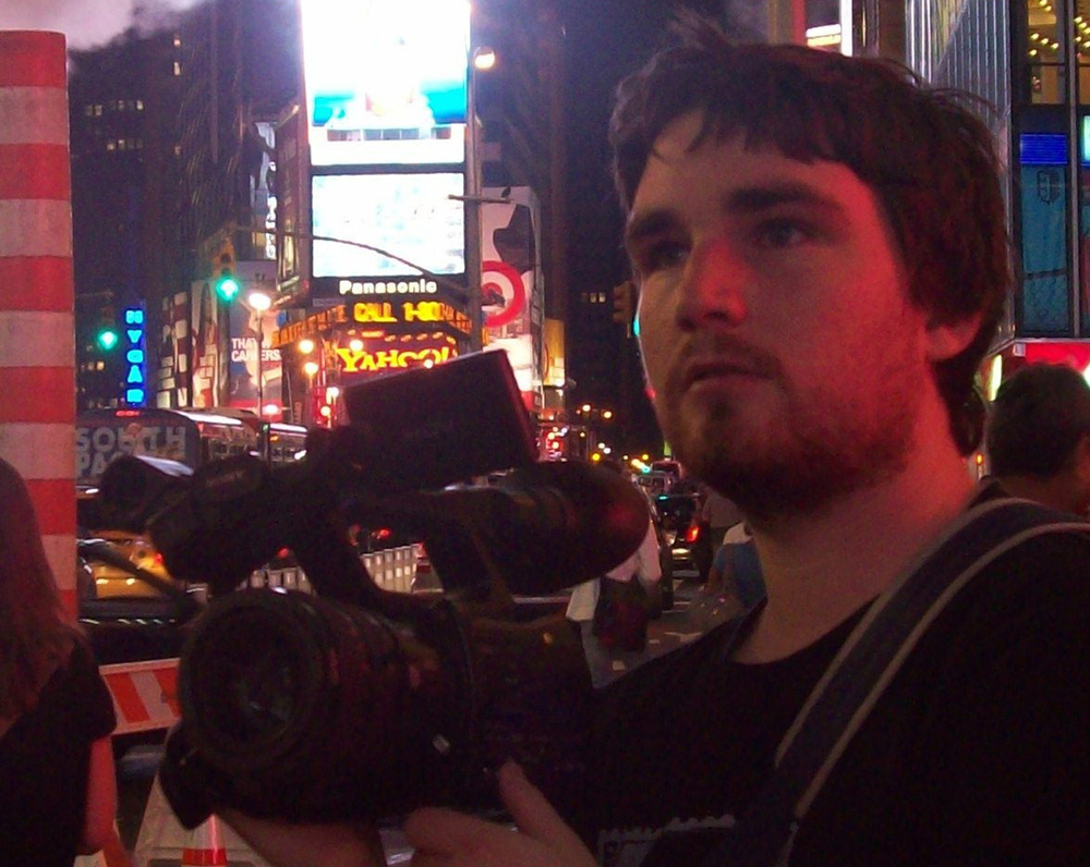 Director Aidan Prewett filming in Times Square, NYC.