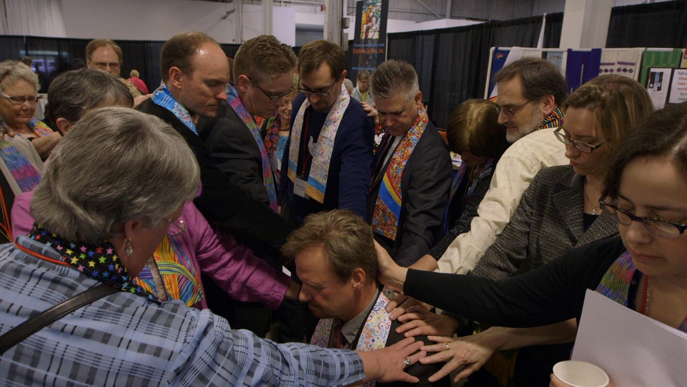Former colleagues lay hands on Rev. Frank Schaefer at the Eastern Pennsylvania Annual Conference in 2014.
