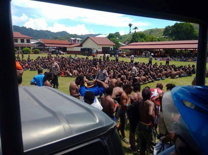 From Jason Mcleod: Last Monday (2 May) the Indonesian police arrested nearly 2000 people. As the jail cells filled up there was no where to hold those arrested. This picture shows the police detaining people on the sports oval of the mobile police brigade's grounds in Kotaraja, Jayapura (Port Numbay). You can see that the police have stripped the activists down to their pants. They kept them there all day in 35 degree heat without water.