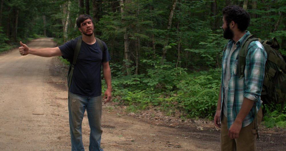 Caption:  Stranded deep in the woods of Maine the two men, strangers now, are forced to confront the teenagers they were, the promises they made, and the men they've become.