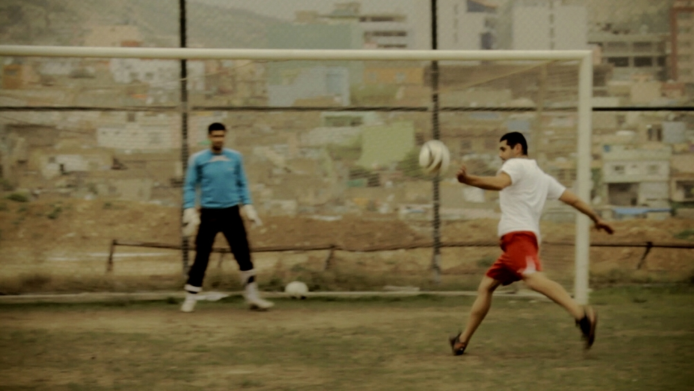 During his tryout for a professional soccer team in Kurdistan Iraq, where his parents were born, Mikael connects on a volley as he hopes to impress onlooking coaches.