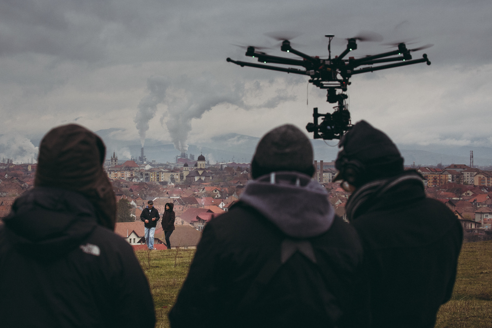 POP-UP 2: Shooting in the heart of Transylvania, Romania overlooking the town called Sebes. A factory which processes wood blows huge plumes across the horizon. We filmed with a drone during several scenes in Romania. (Photo by Dan Pereț)