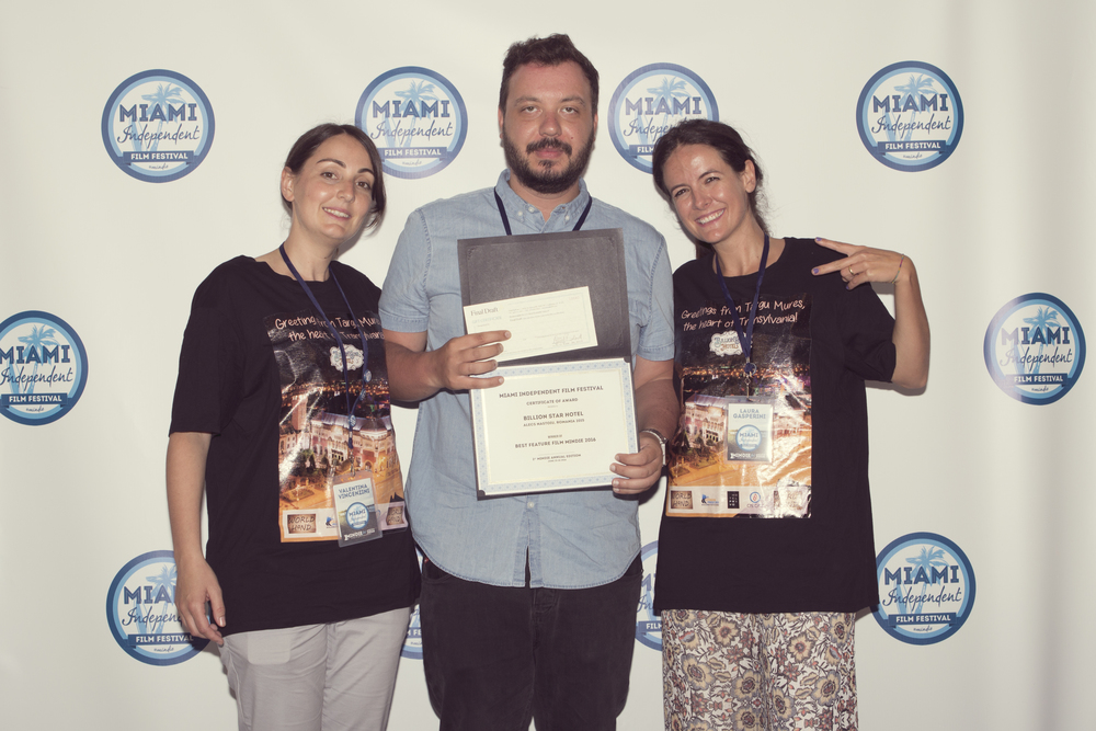 Festival Directors Valentina Vincenzini and Laura Gsperini with Best Feature Film's Director Alecs Nastoiu.