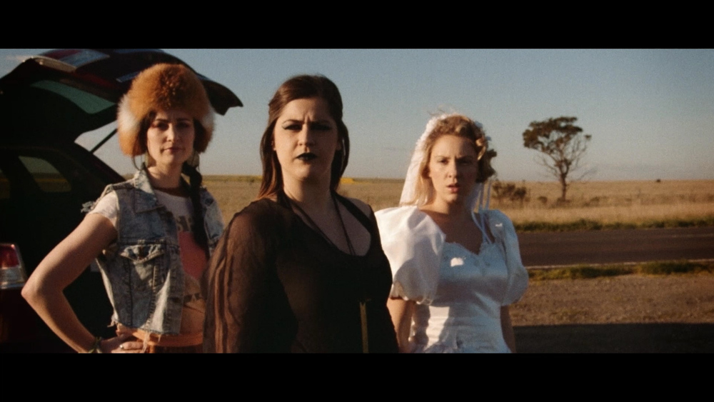 The Happiest Day of my Life - The murderous three watch Thomas' ill-fated escape (L-R Aimee Sanderson, Isabelle Bertoli & Jeni Bezuidenhout).