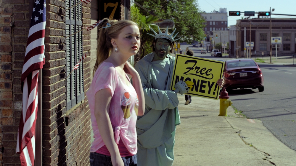 Allie meets an interesting Statue of Liberty (Joe Otcherbeck) character on the streets.